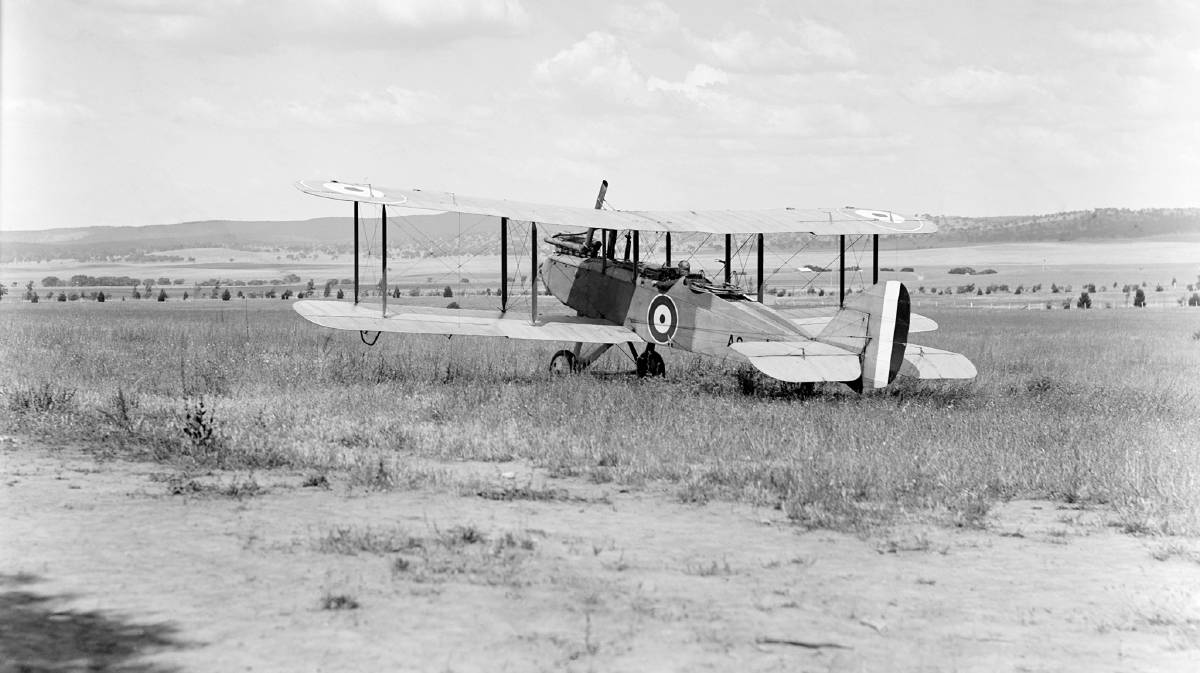 A RAAF De Havilland DH9 on the aerodrome at Dickson in 1925, with the pilot in the cockpit. Picture: Facebook