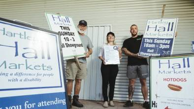 Hall markets volunteer Tony Morris, manager Mel Hugg, and Scott's Food Vans owner Scott Evans at the Hall showground on Friday ahead of Sunday's re-opening of the markets after a year. Picture: Dion Georgopoulos