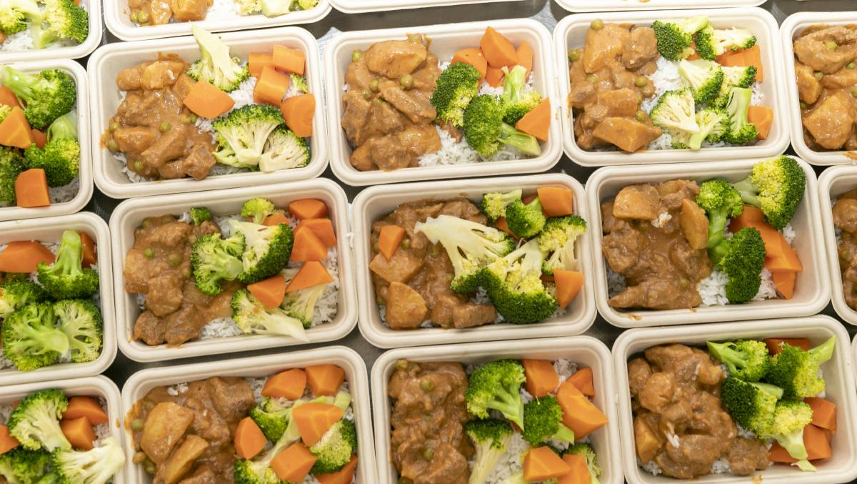 Some of the nutritious meals leaving the kitchen of the National Convention Centre on Friday. Picture: Keegan Carroll
