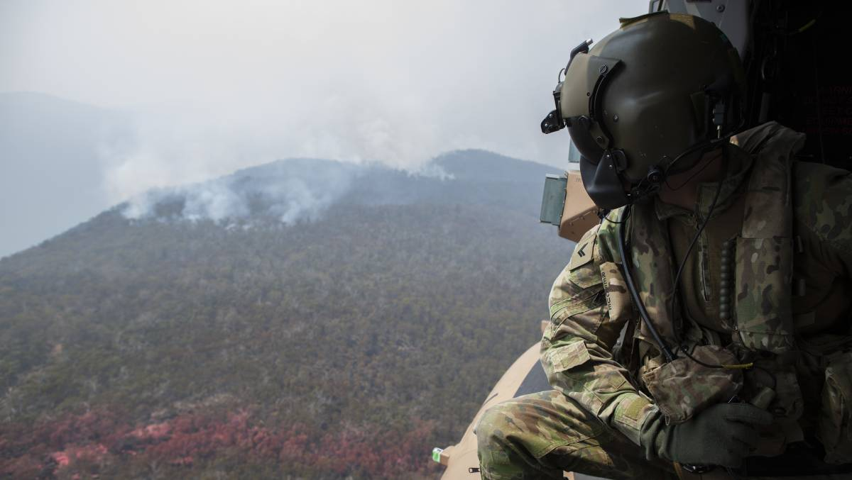 An Australian Defence Force member observes the area near Mount Ginini close to the NSW and ACT border in January. Picture: Department of Defence