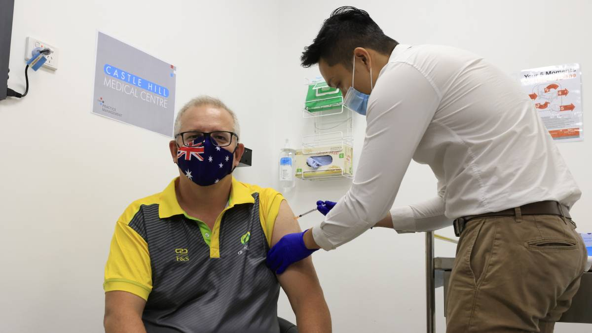 Prime Minister Scott Morrison receives a COVID-19 vaccination at Castle Hill Medical Centre on Sunday. The Australian COVID-19 vaccination program officially begins on Monday. Picture: Getty Images