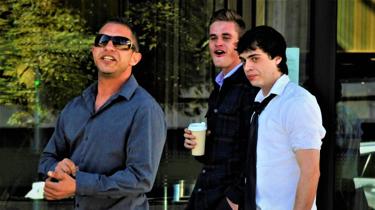 Jaxson Kirkwood (white shirt) leaves court with his supporters on Monday. Picture: Blake Foden
