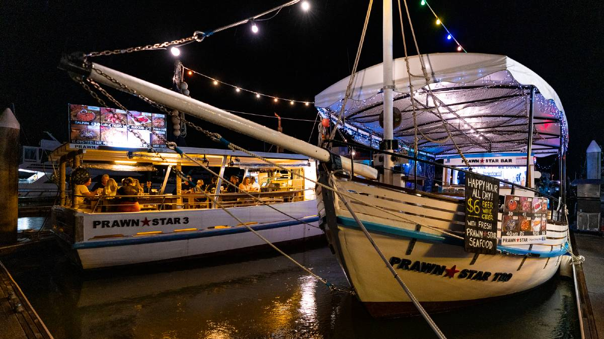 Prawn Star serves seafood platters on old trawlers.