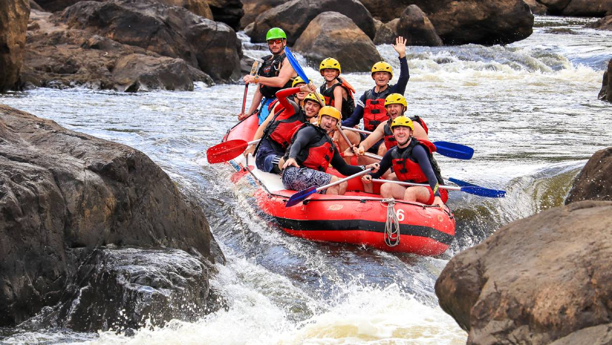 More excitement for Michael (middle right) as he rafts through the rapids at Barron River. Picture: Cairns Adventure Group