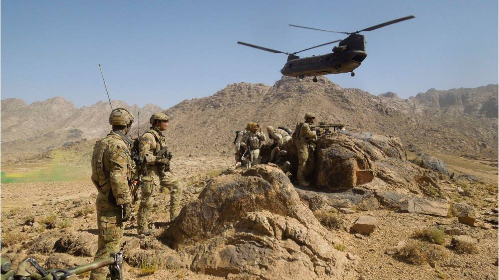 Australian Army soldiers from Special Operations Task Group establish a position after disembarking a US Army CH-47 Chinook helicopter with their Afghan National Security Force partners at the start of a cordon and search mission in Kandahar province, southern Afghanistan, in 2012. Picture: Department of Defence