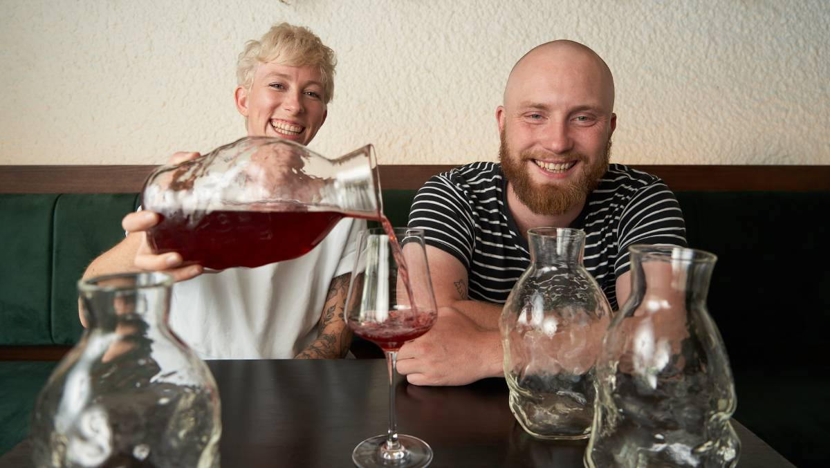 Dash Rumble and Ross McQuinn with the decanters, designed by Scott Chaseling. Picture: Matt Loxton
