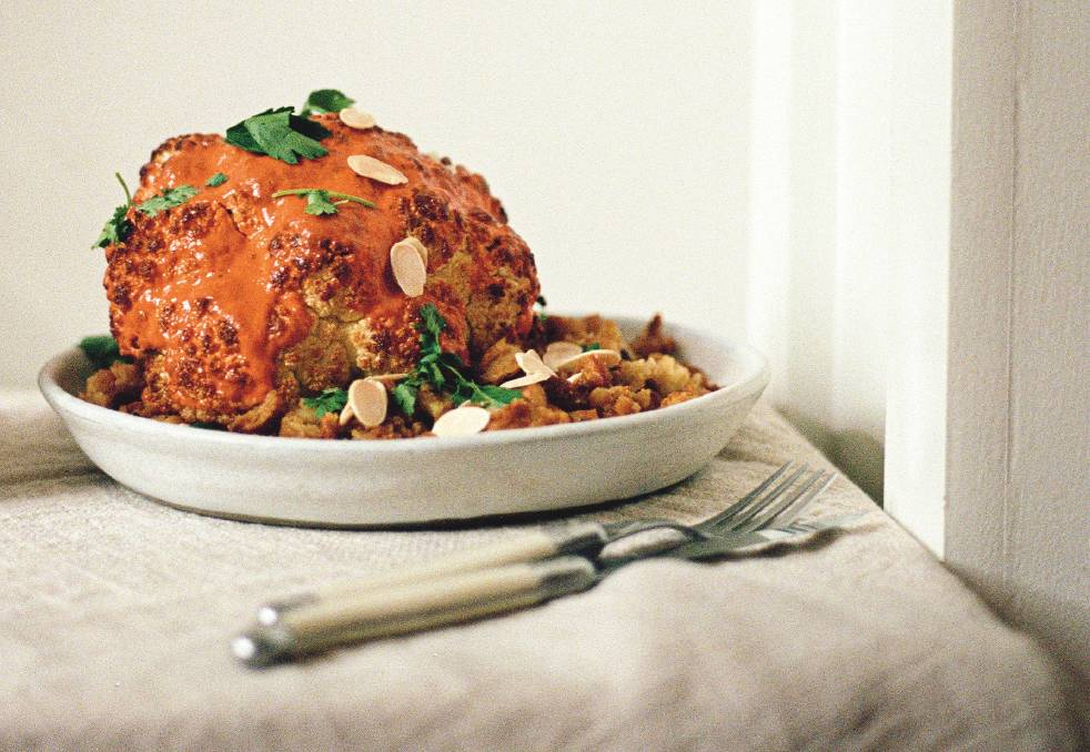 Whole roasted gochujang cauliflower with smashed roasted butter beans. Picture: Hetty McKinnon