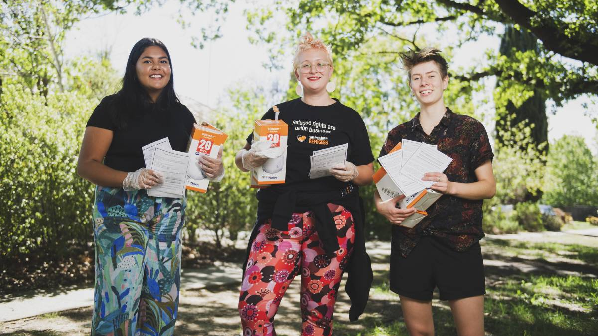 Canberra Region Coronavirus Mutual Aid group members Zoe Ranganathan, Tamara Ryan and Clare Lucre holding free masks and flyers offering help to people across the community during the crisis. Picture: Dion Georgopoulos