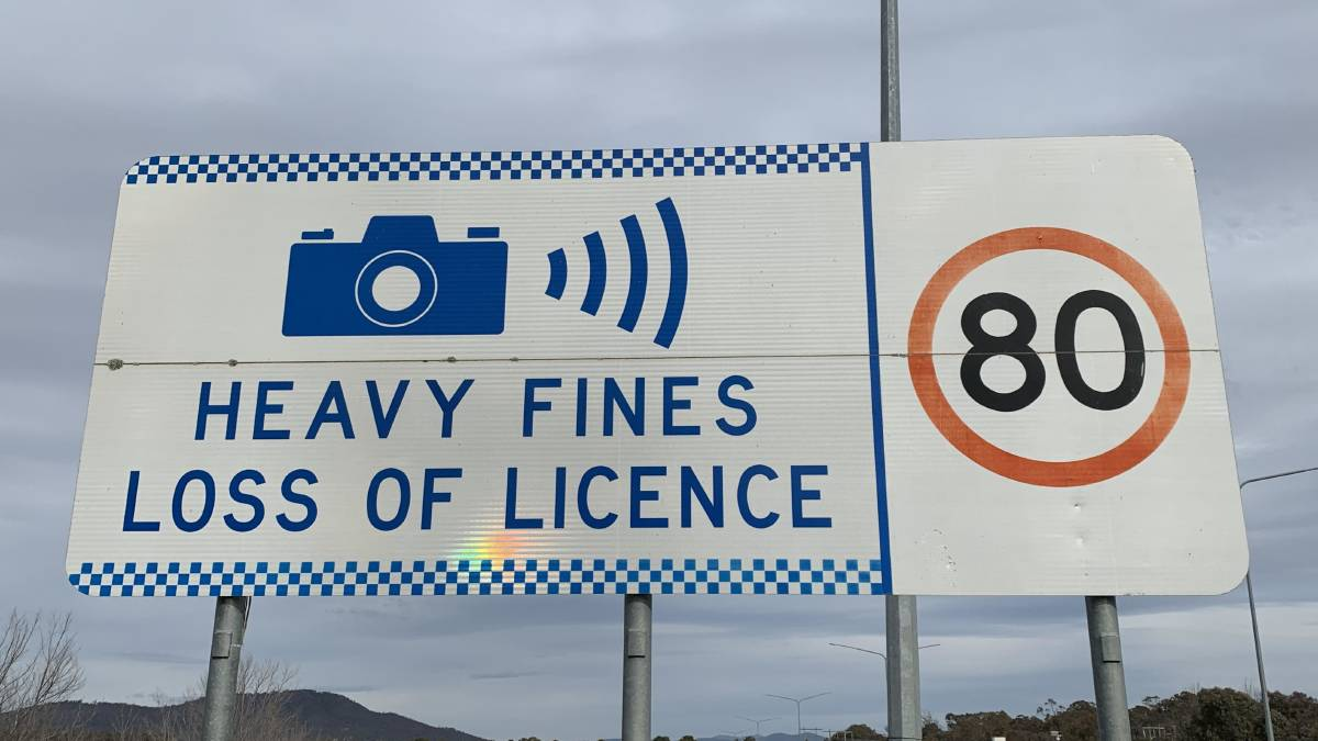 A fixed traffic speed camera warning sign in Canberra. Picture: Peter Brewer