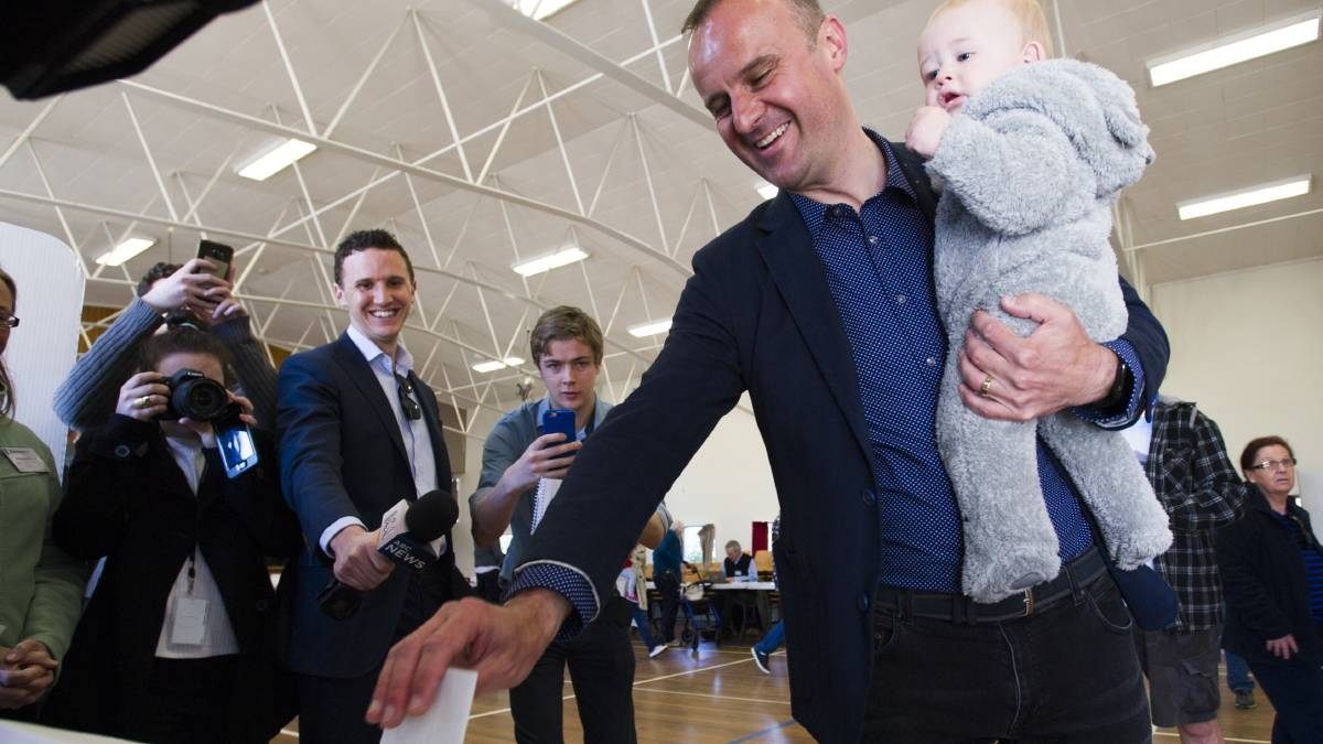 Chief Minister Andrew Barr votes at Ainslie North Primary School with nephew Angus Barr. Picture: Elesa Kurtz