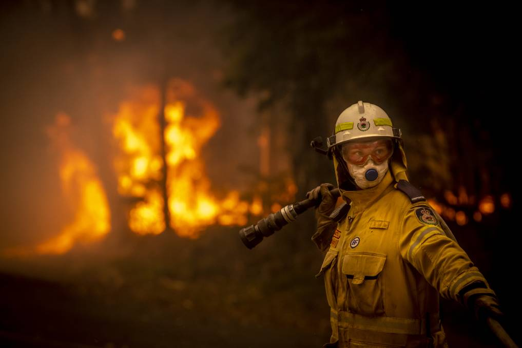 Stacey Wilson from the Milton Volunteer Rural Fire Brigade at the bushfire front on Murramarang Road in Bawley Point on December 5, 2019. Picture: Sitthixay Ditthavong