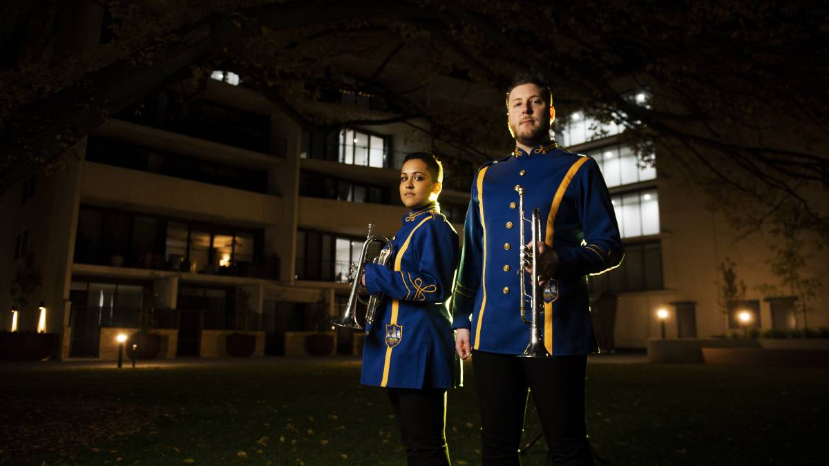 Canberra City Band trumpet players Farzana Choudhury and Keyden Bruce outside their Braddon apartment, where they will be performing the Last Post from their driveway. Picture: Dion Georgopoulos