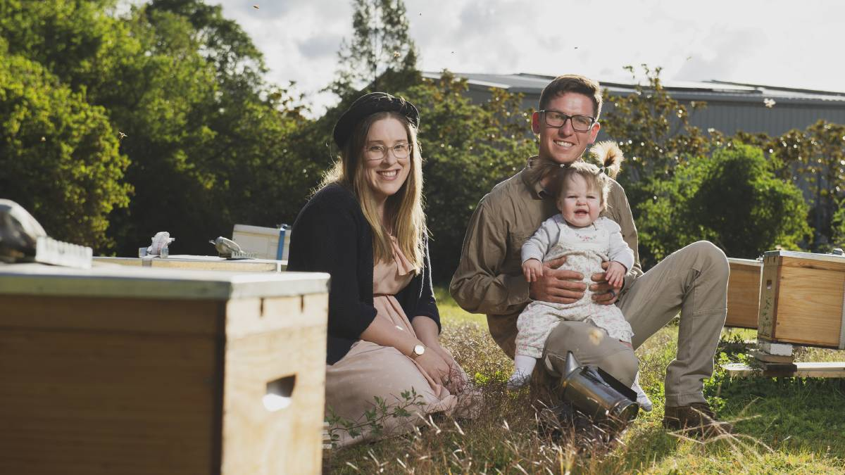 B*keeper owners Megan and Andrew Colwell with daughter Amelia at one of their apiary sites. Picture: Dion Georgopoulos