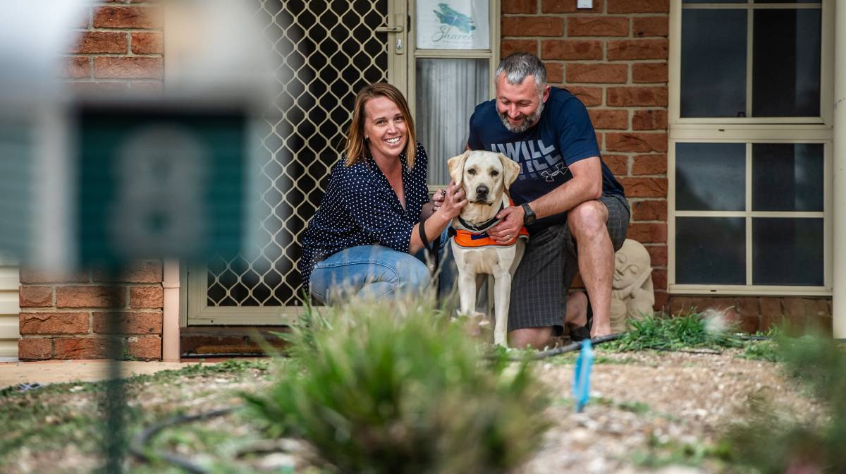 Sharee and Wayne Hargreaves and puppy Zander in Jerrabomberra on Wednesday. Picture: Karleen Minney