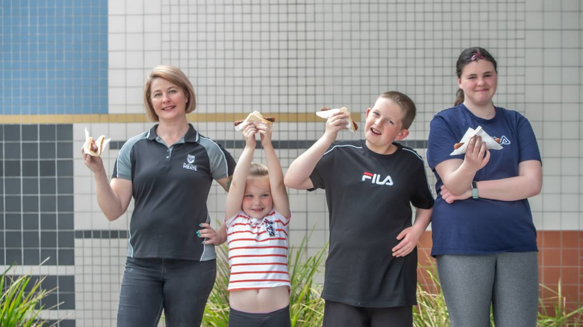 Kristy Alderson of Platinum Meats has donated sausages to the Namadgi School for their election sausage drive, pictured with Ashleigh Ellison, Year 1, Nathan Nowak, Year 6 and Maddie Nowak, Year 8. Picture: Karleen Minney