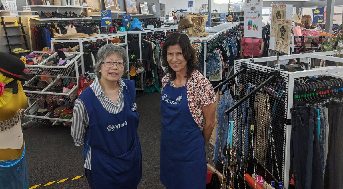 Vinnies Tuggeranong volunteers Caresa Santos and Rhonda Sekoranja at the store on Friday.