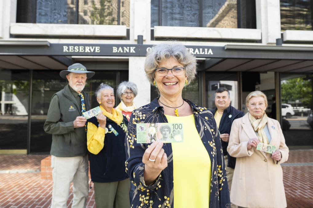 Wattle Day Association members Warwick Wright, Pat Wright, Chris Alexion, Suzette Searle, Dr Phillip Kodela, and Dawn Searle outside the Reserve Bank in Canberra on Thursday with the new $100 wattle note. Picture: Dion Georgopoulos