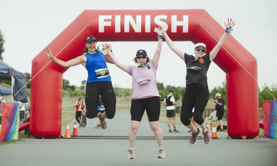 Stromlo Running Festival participants Alana, Tiffany, and Naomi Mahon celebrate finishing the 10km run on Sunday. Picture: Dion Georgopoulos