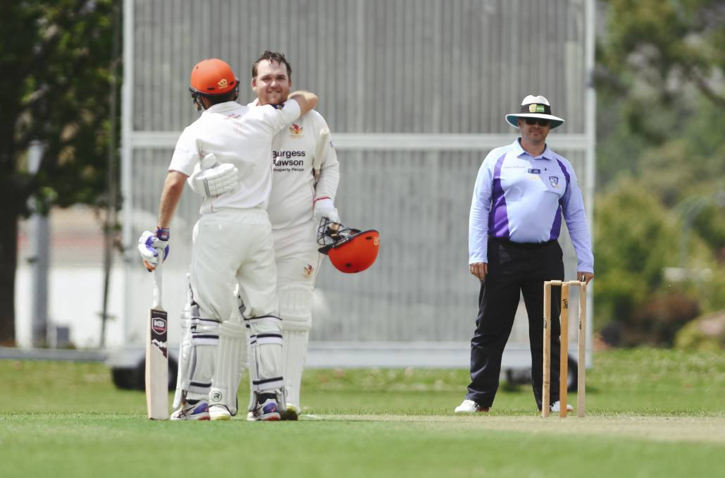 Michael Barrington-Smith hugs Craig Devoy after he scored a century. Picture: Dion Georgopoulos