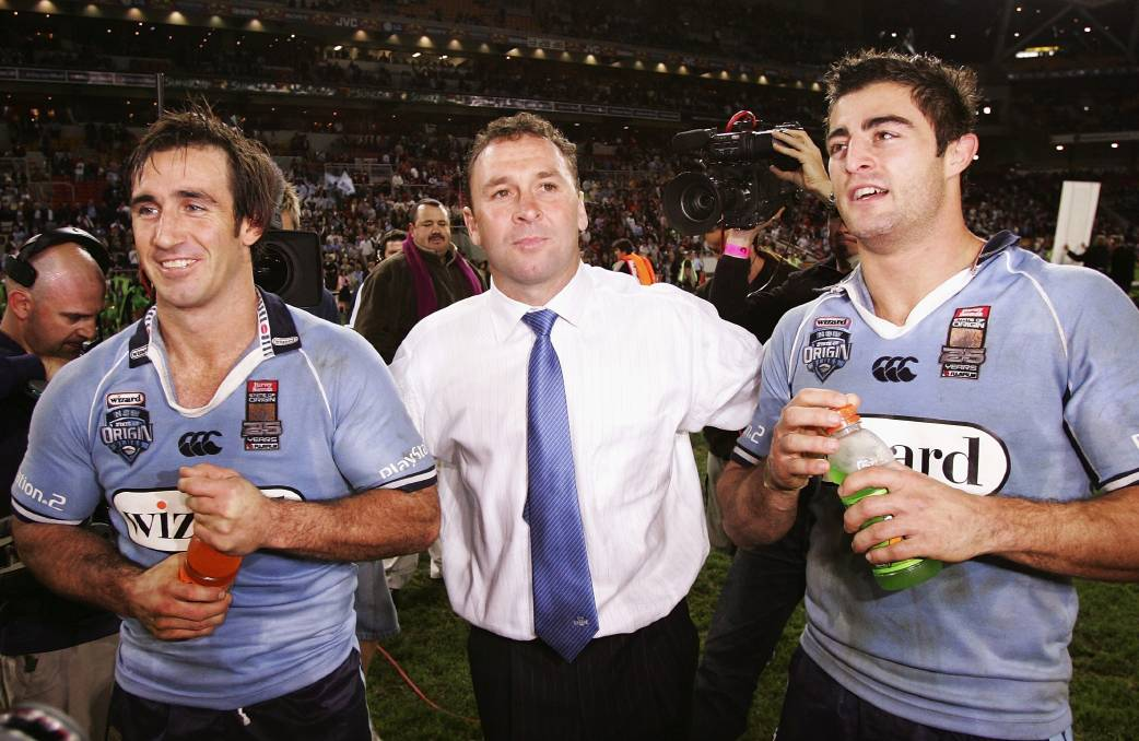 Ricky Stuart, middle, celebrates the 2005 Origin series win with Andrew Johns and Anthony Minichiello. Picture: Getty Images