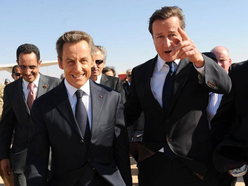 David Cameron (R) says Nicolas Sarkozy (L) helped him see his father for the last time.