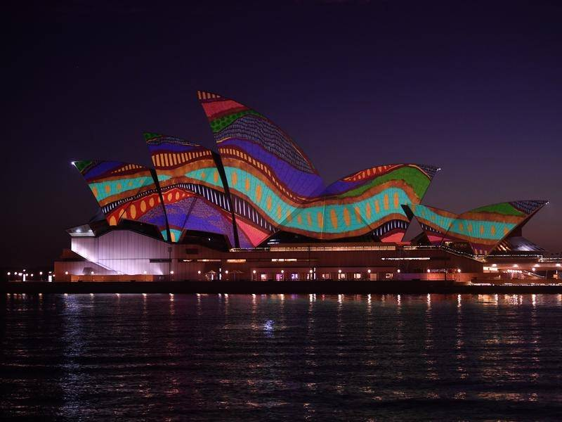 The Sydney Opera House was lit up at dawn on Tuesday with an Indigenous artwork titled Angwirri.