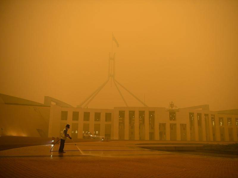 Smoke from bushfires in NSW has turned the sky in Canberra orange .