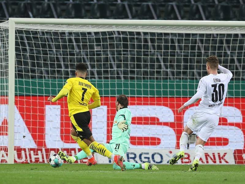 Jadon Sancho has scored the game's only goal in Dortmund's German Cup win at Monchengladbach.