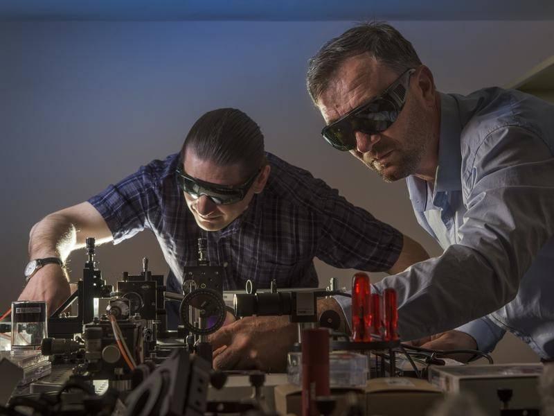 Vladlen Shvedov and Andrey Miroshnichenko's laser tractor beam may allow them to control lightning.