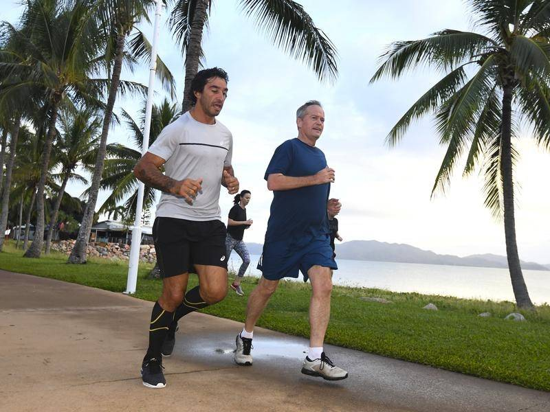 Rugby league star Johnathan Thurston joined Bill Shorten for an early morning run.