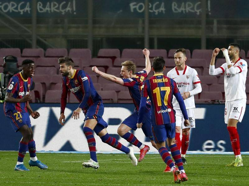 Gerard Pique's late headed goal gave Barcelona the momentum in their Spanish Cup win over Sevilla.