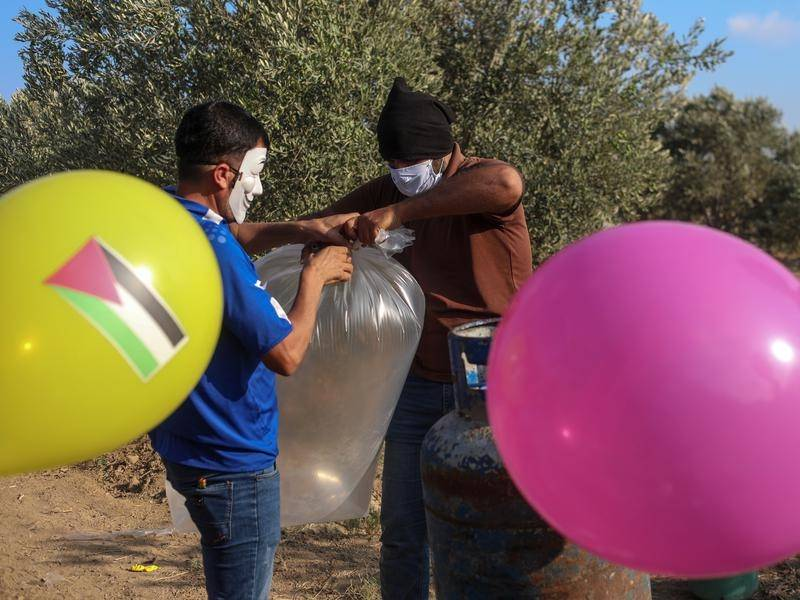 Incendiary balloons launched from Gaza have prompted a retaliatory Israeli strike.