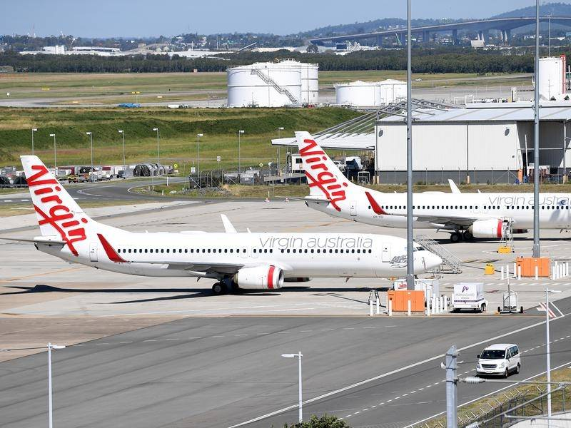 A Virgin Airlines plane has become the first aircraft to depart from Brisbane airport's new runway.