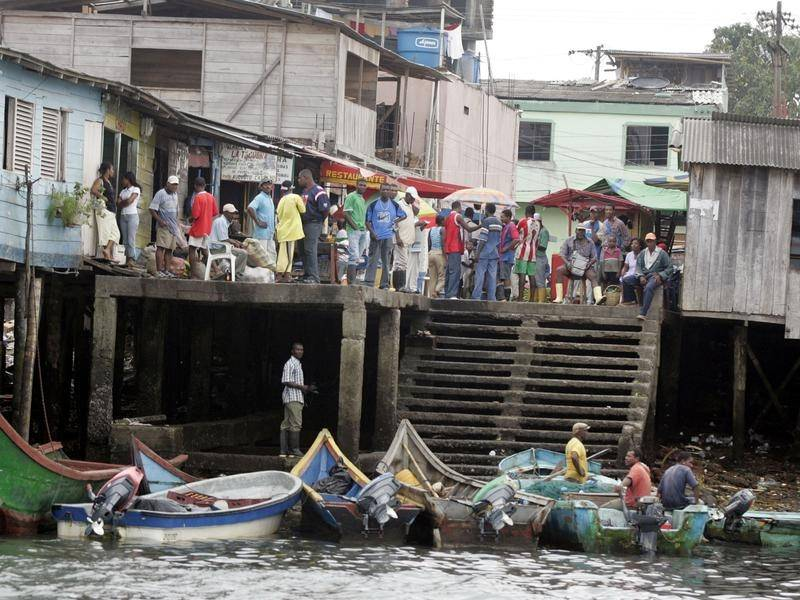 Twelve people are dead after two boats sank close to the Colombian fishing port of Tumaco.