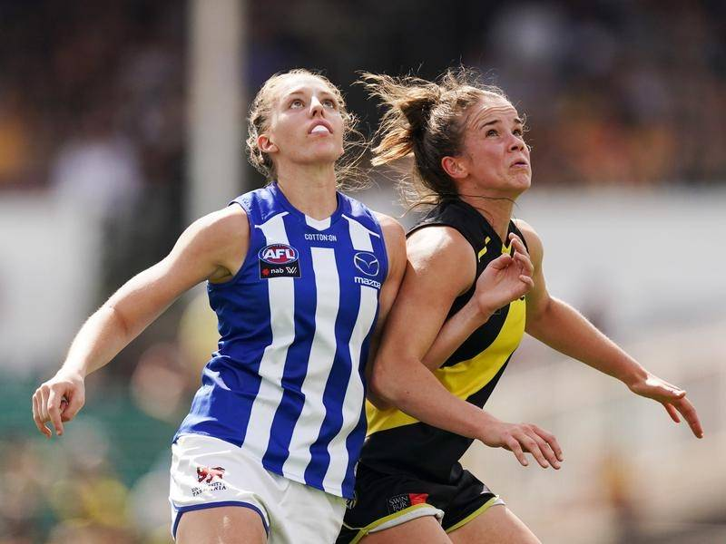 Emma King (l) put in a dominant display as North Melbourne beat Richmond by 35 points in the AFLW.