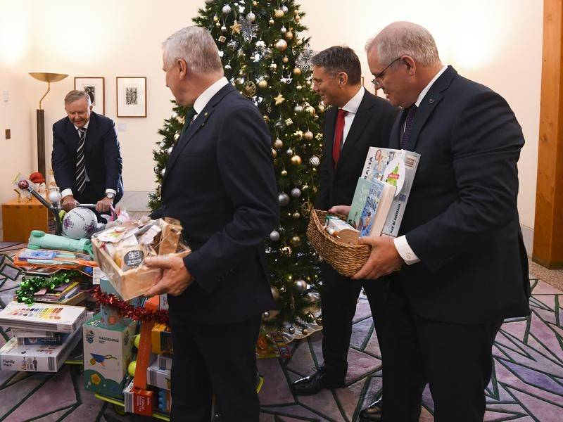 Political leaders came bearing gifts for the annual charity Christmas tree.