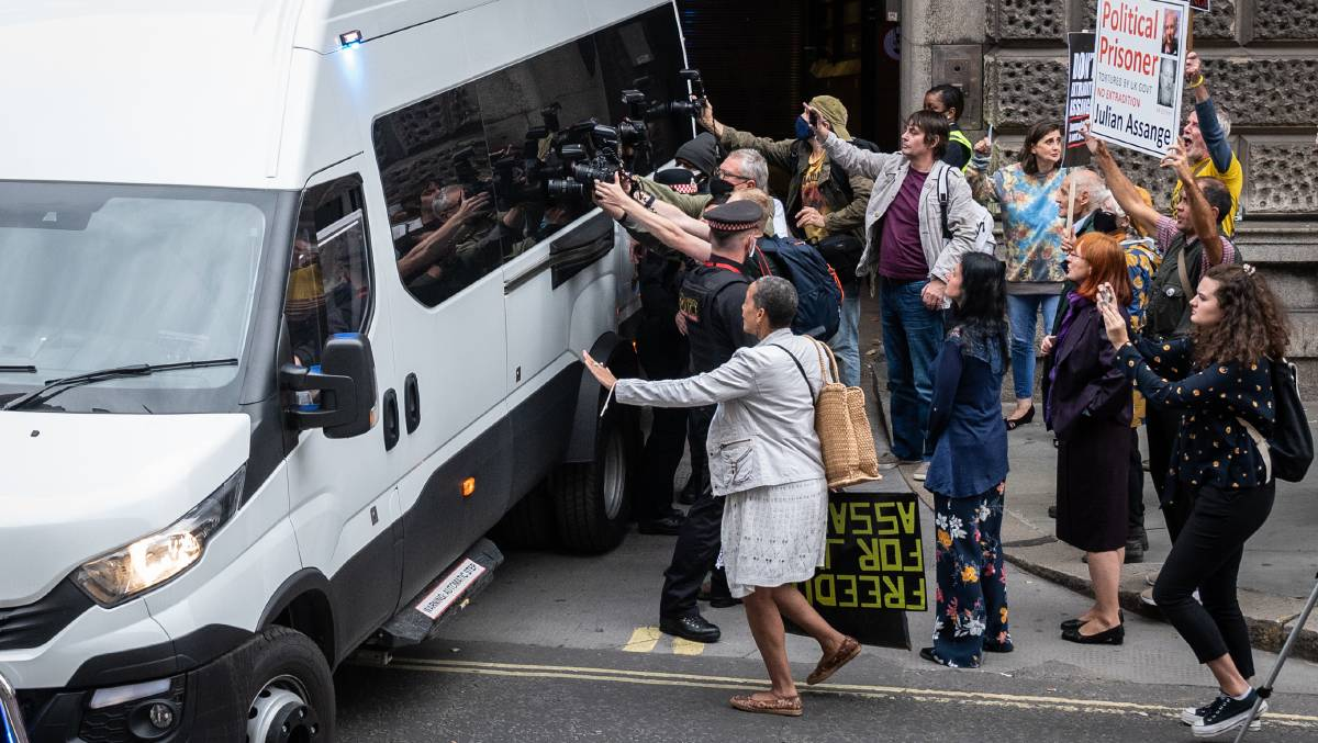 Supporters of Julian Assange gather at the exit to Old Bailey as a van believed to be carrying the Wikileaks founder leaves his extradition hearing. Picture: Getty Images