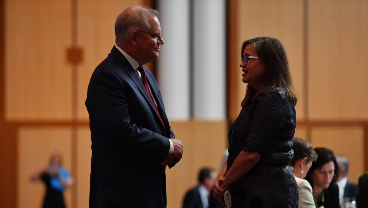 Sex discrimination commissioner Kate Jenkins (right) speaks to Prime Minister Scott Morrison at the International Women's Day Parliamentary Breakfast in February. Picture: Getty Images