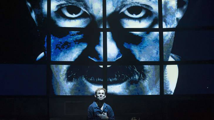 Big Brother watches over Winston Smith (Bryan Probets) in shake & stir theatre co's production of George Orwell's 1984. Picture: Supplied