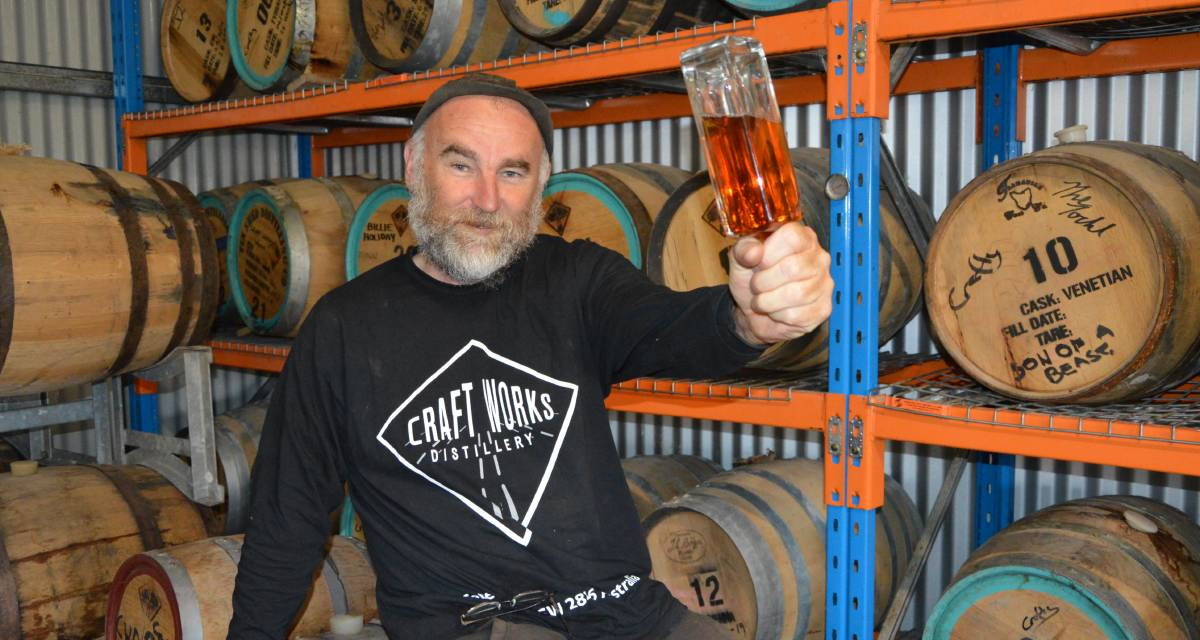 WHISKY PLEASE: Craft Works Distillery owner Craig 'Crafty' Field with Project Ian. Photo: ALANNA TOMAZIN.